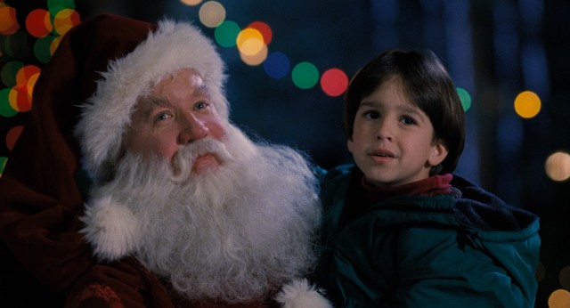 In his breakout film role, Tim Allen plays Scott Calvin, a divorced father who becomes Santa Claus to his son's (Eric Lloyd) excitement.