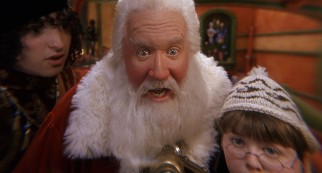 Santa Claus (Tim Allen) discovers the Mrs. Clause in the even smaller print hiding deep within his business card.