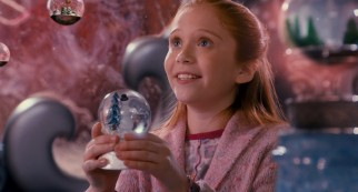 Lucy (Liliana Mumy), the preteen daughter of Scott's ex-wife and her new husband, rises in prominence with her warm hugs and snowglobe appreciation.