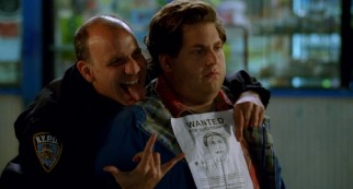 Officer Frank (Nick Sandow) takes a celebratory photo with Noah (Jonah Hill) and his police sketch.