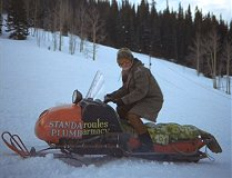 Slow-witted neighbor Wally shows off his snowmobile, made from scraps.