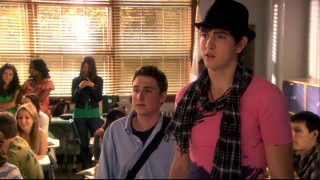Cameron (Nicholas Braun) takes Michael's (Kyle Kaplan) advice to try peacocking, but the pink shirt, hat, and scarf look only give Bianca more reason to suspect he's gay.