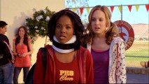 Chastity (Dana Davis) is surprised to learn that the new student that put her in a neck brace is related to the aspiring cheerleader on her left.