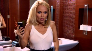 Ho ho no! Christmas is ruined when E.J. Baxter (Kristin Chenoweth) catches her fiancé and her boss getting friendly in a bathroom stall.
