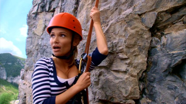 "Dressed for ""ab-sailing"" not abseiling, E.J. (Kristin Chenoweth) experiences dramatic fright on this Montana mountain descent."