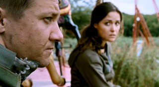 Sympathetic American soldiers Sgt. Doyle (Jeremy Renner) and Maj. Scarlet (Rose Byrne) play surrogate guardians to the two Harris children.