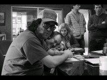 "Judah Friedlander is caught in this candid shot from the ""30 Rock"" backstage photo reel."