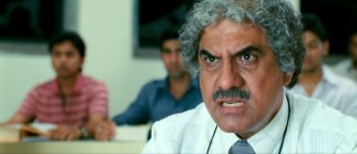 "ICE's high-powered director Viru ""Virus"" Sahastrabudhhe (Boman Irani) is not amused by Rancho's lesson."