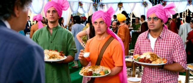 The three idiots -- Raju (Sharman Joshi), Rancho (Aamir Khan), and Farhan (R. Madhavan) -- are surprised to see a familiar and intimidating face at the wedding they crash.