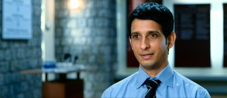 Complete candor may hurt Raju's (Sharman Joshi) chances at this important job interview. The low grades, juvenile criminality, and mental instability probably don't help either.
