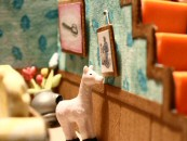 "A llama adjusts a framed wall picture of he and his owner in Isabela Dos Santos' contest-winning stop-motion short ""Obsessive Compulsive."""