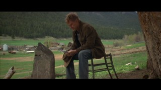 The stubbled Einar (Robert Redford) opens up to his late son.