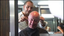 """From the Top Down: Stylizing Character"" shows Tony Scott greatly enjoying a trim from hair stylist Danny Moumdjan."