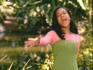 "Tiffany Evans performs in the music video for the end credits version of ""Who Am I?"""