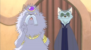 The cross-eyed Cat King and his beatnik right-hand cat.