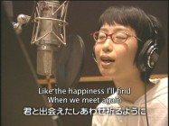 Ayano Tsuji records the closing song in the making-of documentary.