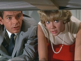 Dean Jones and Hayley Mills look for the missing bits of picture. Are they under the bed? No, but D.C. is.