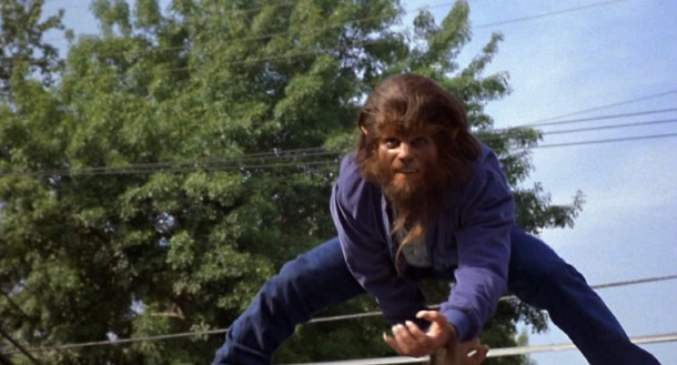 "To the sounds of The Beach Boys' ""Surfin' U.S.A."", Teen Wolf (Michael J. Fox or possibly a stunt double) has the confidence to surf atop the moving Wolfmobile."