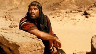 Getting banished to the desert with a single day's food and water supply seems like a death sentence for Moses (Charlton Heston).