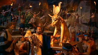 Dathan (Edward G. Robinson) leads the Hebrew people in celebration around a golden calf, at the same time that God is expressly condemning such an act.