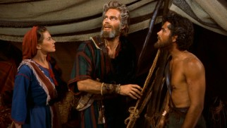 Moses (Charlton Heston) shares few specifics of his fiery God chat with Joshua (John Derek) and Lilia (Debra Paget).