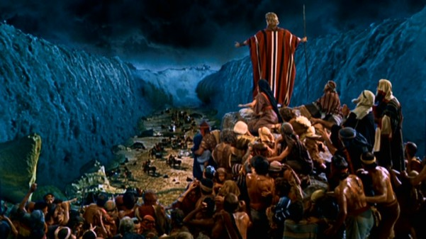 "Allowing his people to escape, Moses parts the Red Sea temporarily in the most iconic sequence of Cecil B. DeMille's ""The Ten Commandments."""