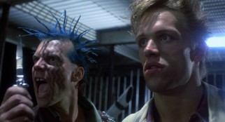 Just 27 years old when they made it, Bill Paxton makes his first of thus far five James Cameron movie appearances, playing the spiky blue-haired, face-tattooed Punk Leader whose gang's clothes are sought by the Terminator.