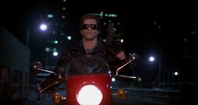 Wearing his sunglasses at night, the Terminator (Arnold Schwarzenegger) is relentless in his pursuit of Sarah Connor.