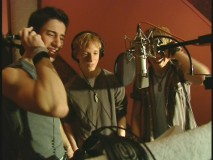 "An anonymous boy band singing ""Three is a Magic Number."""