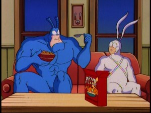 Superheroes eat cereal just like you and me. (Of course, your local supermarket might not sell Drama Flakes.) Arthur observes, as The Tick finds battle cry possibilities in his sugary-good snack.