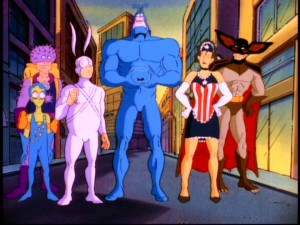 "The core cast of ""The Tick"" (plus Fishboy) strikes a superheroic pose. Appearing left to right: Sewer Urchin, Arthur, The Tick, American Maid, and Die Fledermaus."