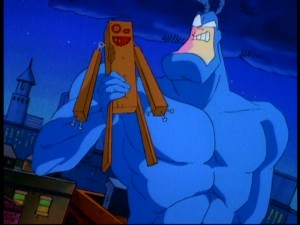 The Tick shows off his new pal, the lovely wooden boy he made on a Hobby Night spent alone.