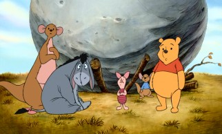 Kanga, Eeyore, Piglet, Roo, and Pooh look at Rabbit as he announces his plans to remove the boulder that has crushed the donkey's home.