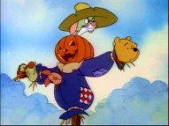 "Tigger, Rabbit, Pooh, and Piglet pop out of four spots of a scarecrow in the bonus ""New Adventures of Winnie the Pooh"" episode ""Tigger's Houseguest."""
