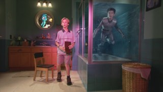 As Sharkboy, young Taylor Lautner keeps in a shark tank while Max (Caden Boyd) looks concerned.