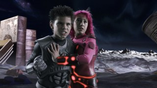Sharkboy (Taylor Lautner) and Lavagirl (Taylor Dooley) are part of the 3-D Land of Milk and Cookies.