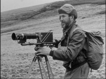 Herb Crisler sets up his video camera to capture the behavior of animal life in the Canadian wilderness.
