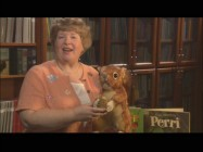 Stacia Martin shows off a Perri doll from the '50s, something you're unlikely to find in the Disney Store today.