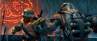"Brother (Leonardo) fights armored brother (Raphael, in Nightwatcher gear) in one of the most memorable scenes of ""TMNT."""