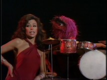 Rita Moreno has a word with Animal about his upstaging drum-playing.
