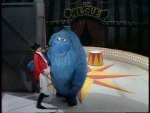 Harvey Korman tries to tame a not-too-intimidating Thog.