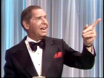 Milton Berle points out the location of the two hecklers in the balcony.