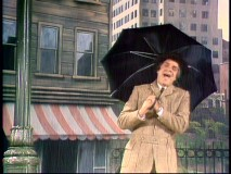 "Impressionist Rich Little recreates a memorable scene from ""Singing in the Rain."""