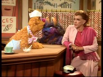 At a luncheon, Nancy Walker orders from Fozzie Bear while sitting next to a Monster. Bad idea!