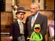 An elderly Edgar Bergen and still sharp Charlie McCarthy have Kermit laughing backstage at the Muppet Theatre.