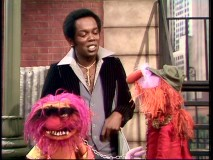Lou Rawls tries to coolly offer Animal a drumming gig, with Floyd serving as interpreter.