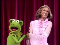 Cloris Leachman has the luck to appear on an episode when pigs take over The Muppet Show. Here, she smiles with the porcine stand-in for Kermit.