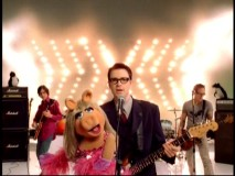 "Miss Piggy, penguins, and many unseen Muppets accompany Weezer in their delightful 2002 music video for ""Keep Fishin'."""