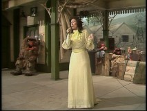 "Country legend Loretta Lynn sings in a train station, the temporary home of the ""Muppet Show"" while the usual theater is fumigated."