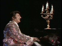 Liberace glitters while making eyes at a seductive candelabra.